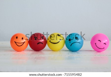 Emotions balls background, Happy Smiley faces ball in yellow , orange and pink. Sadness ball in blue and madness ball in red. Self made hand draw balls. #715595482