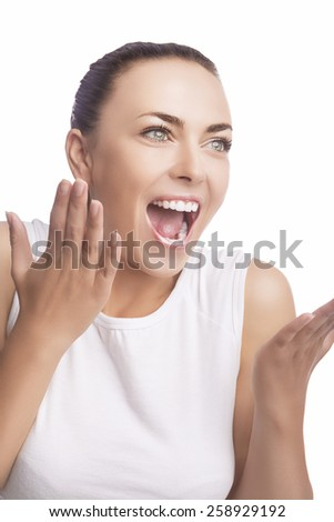 Emotions Concept: Portrait of Excited Caucasian Brunette Female Showing Positive Facial Expression. Isolated Over Pure White. Vertical Shot