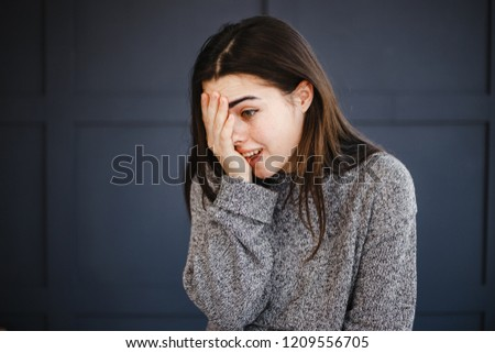 Emotions, feelings and face expression. Facepalm. Confused young woman covering her face. Shame, confuse, fun concept Stock foto ©