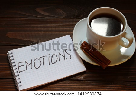 Emotions inscription and word in a notebook near a cup of coffee #1412530874