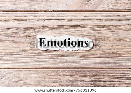 EMOTIONS of the word on paper. concept. Words of EMOTIONS on a wooden background. #756811096