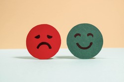 Emotions: positive, neutral and negative (red, yellow and green different moods). Rating smile for customer opinion. Paper cut. Mental health assessment, feedback rating and review concept.