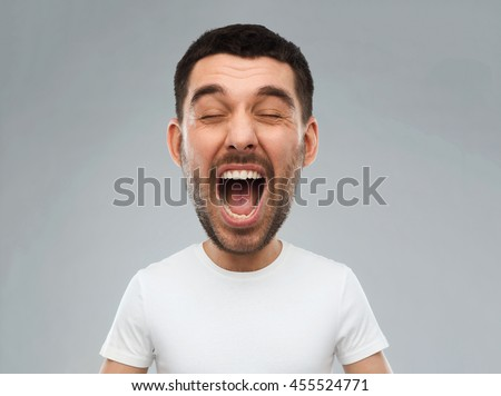 emotions, stress, madness and people concept - crazy shouting man in white t-shirt over gray background (funny cartoon style character with big head) #455524771