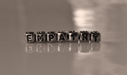 Empathy -  word from metal blocks  - concept sepia tone photo on shine background
