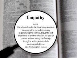Empathy word in a dictionary. Close up of an English dictionary page with word empathy