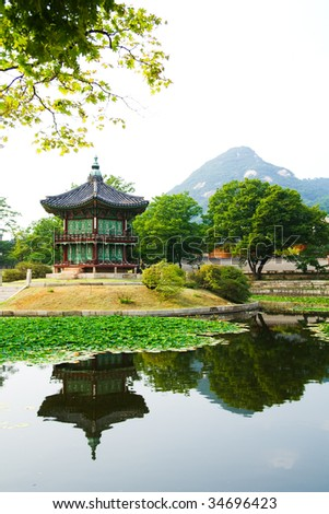 Emperor palace at Seoul. South Korea. Lake. Mountain. Reflections - stock photo