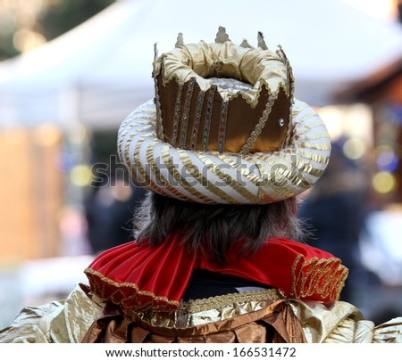 Emperor\'s Crown with a medieval dress of the time seen from behind