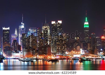 Empire State Building, New York City with Manhattan Skyline at night panorama over Hudson River with reflection. - stock photo
