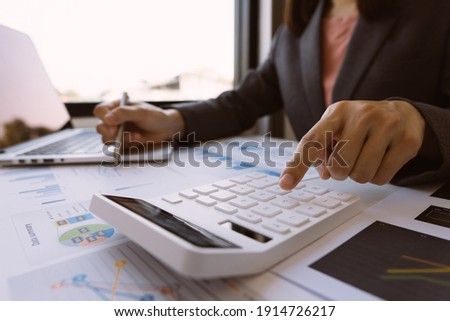 employee accountant man hand press on calculator for make financial report or company's profit monthly at desk , bookkeeper job and work from home concept