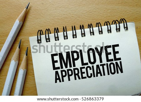 Employee Appreciation text written on a notebook with pencils