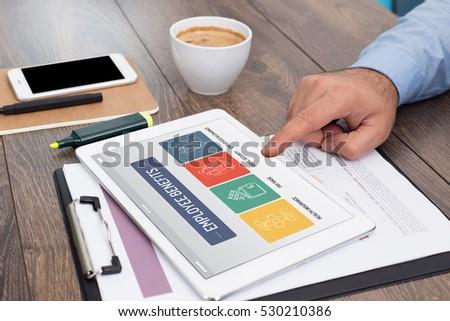 EMPLOYEE BENEFITS CONCEPT ON TABLET SCREEN - Shutterstock ID 530210386