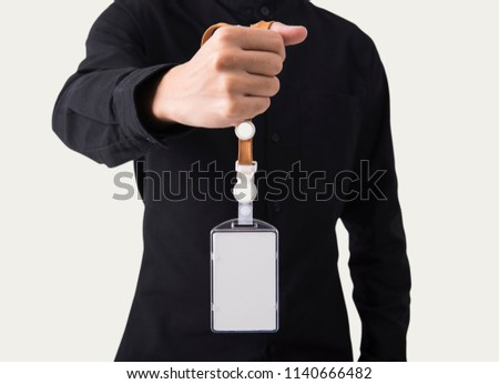 employee hand showing blank id name card badge holder for mockup template logo branding background.