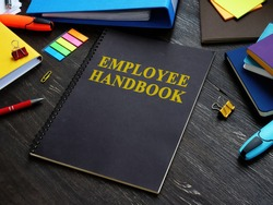 Employee handbook and papers with rules and procedures.