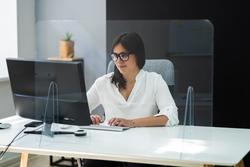 Employee In Office Distancing Using Sneeze Guard Screen