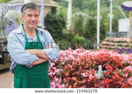 Employee in the greenhouse in garden center