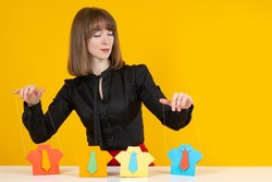 Employee manipulation concept. Manipulation of people in business. Businesswoman runs people like a puppeteer. Manipulation woman controls people with ropes. Employee management in company.