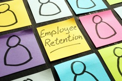 Employee retention sign and figurines on the memo sticks.