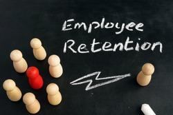 Employee Retention. Wooden figurines on a blackboard.