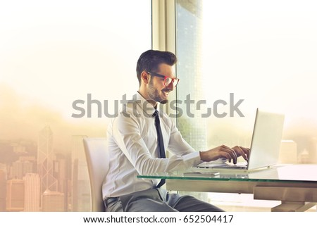 Employee sitting at his desk using a pc #652504417