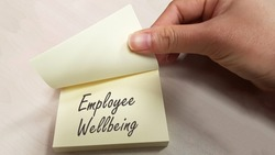 Employee Wellbeing concept using sticky pad