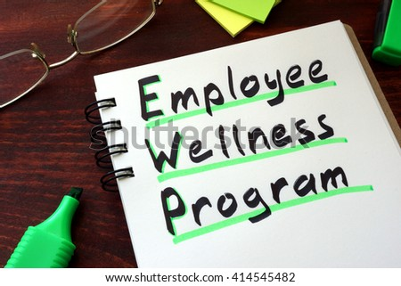 Employee Wellness program written on a notepad with marker. #414545482
