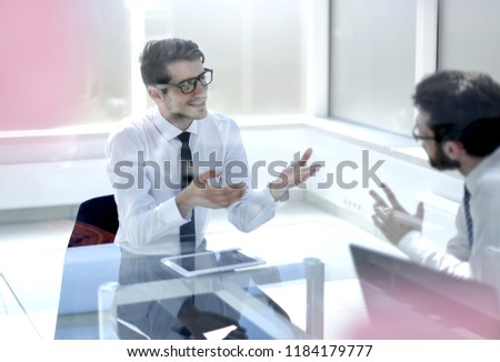 employees discuss ideas for a new business project. #1184179777