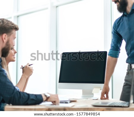 employees discuss something with a visitor to the Agency