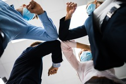 Employees Doing Elbow Bump To Avoid Flu And Stop Covid Spread