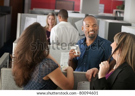 Employees enjoying cup of coffee during break