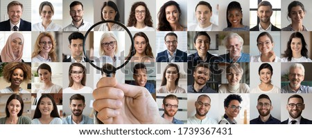 Employer hand holding magnifying glass choosing old middle aged female candidate among young multiethnic professional people faces collage. Human resource, headhunting, senior job opportunity concept. stock photo