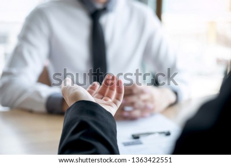 Employer or recruiter holding reading a resume during about colloquy his profile of candidate, employer in suit is conducting a job interview, manager resource employment and recruitment concept. #1363422551