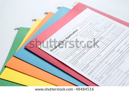 Employment Application Form with colored folders in background