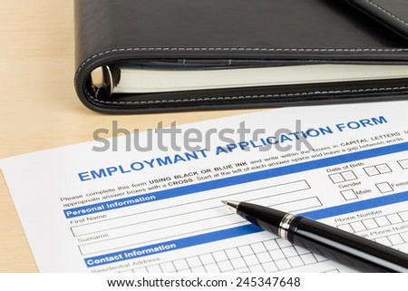 Employment application form with pen and organizer concept job applying