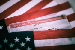 Employment Authorization card covered of USA Flag. Close up view. Toned photo.