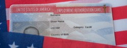 Employment Authorization card on USA Flag surface. Close up view. Wide photo