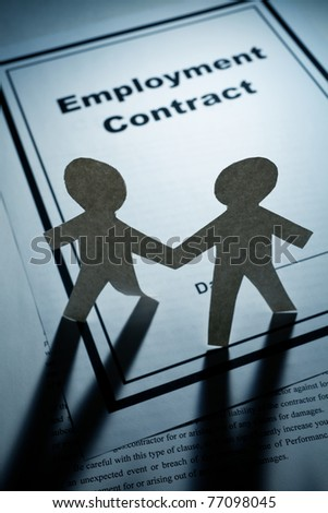 Employment Contract and Paper Chain Men close up