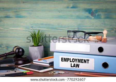 employment law concept. Binders on desk in the office. Business background