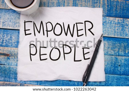 Empower People. Motivational inspirational quotes words. Wooden background