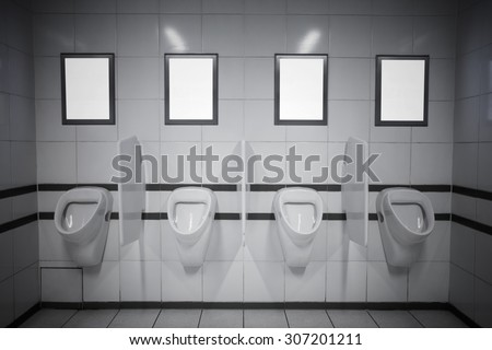 Empty advertisement frames in public toilet