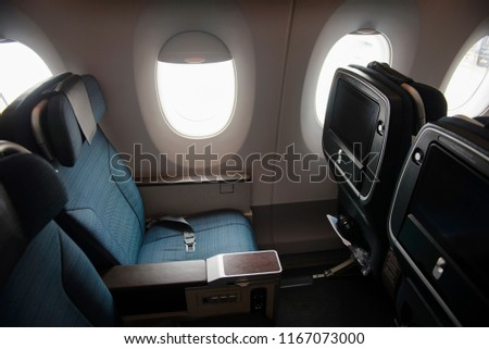 Empty aircraft premium economy class seats and windows