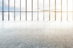 Empty airport hall with window of glass and flying airplane over blue sky background