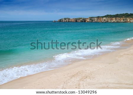 Empty Algarvian beach with inviting blue water