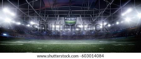 empty american football stadium 3D in light rays at night render #603014084