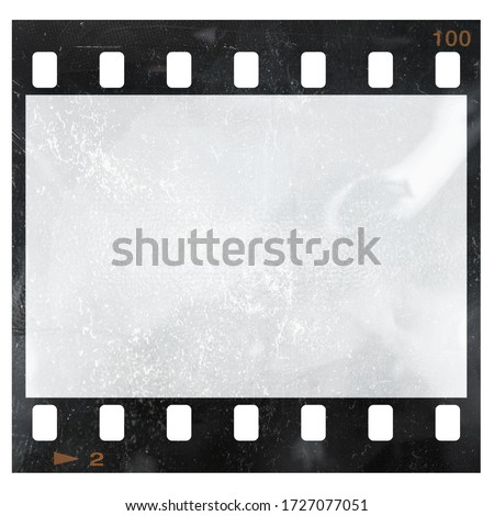 empty and blank 35mm filmstrip with dust isolated on white background and frame edge number two.