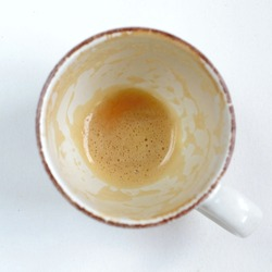 empty and dirty cup of coffee
