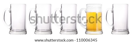 empty and one full beer glass isolated on a white background