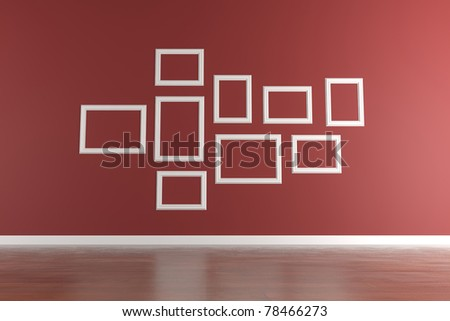 Empty and white picture frame isolated on a red wall