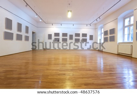 Empty art gallery with blank pictures on the wall - wide angle view