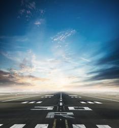 Empty asphalt airport runway with dramatic sky.