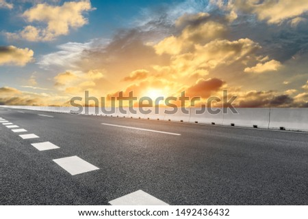 Empty asphalt highway and beautiful sky clouds at sunset #1492436432